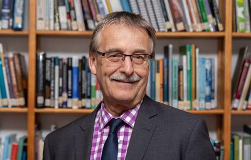 Greg Schollum.