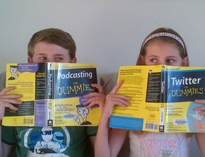 Photo of two children holding podcasting for dummies and twitter for dummies