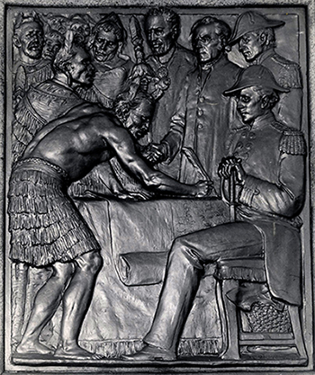 Bronze plaque of treaty signing